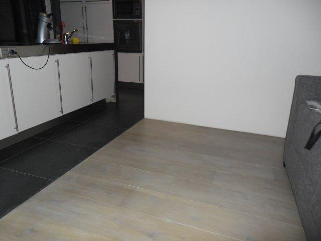 Wij gaan een houten vloer laten leggen door LHP Vloeren